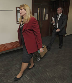 Photo -   Assistant District Attorney Karen Pearson leads the prosecution team into court for a motions hearing for suspected theater shooter James Holmes in district court in Centennial, Colo., on Thursday, Aug. 30, 2012. Holmes has been charged in the shooting at the Aurora theater on July 20 that killed twelve people and injured more than 50. (AP Photo/Barry Gutierrez)