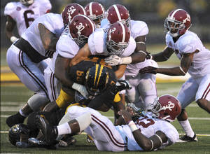 Photo - Missouri, which left the Big 12 in 2011, is still trying to find its place in the SEC. AP PHOTO