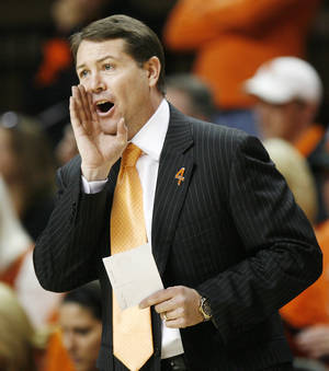 Photo - OSU basketball coach Travis Ford testified Wednesday in the trial of Darrell Williams. Ford said Williams professed his innocence when the coach asked him about the incident. Photo by Nate Billings,  The Oklahoman