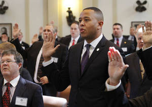 Photo - Rep. T.W. Shannon is sworn in as House speaker-elect on Nov. 14 at the state Capitol. Shannon, 34, will be the first black House speaker and also the youngest to serve in the leadership post. Photo by Jim Beckel, The Oklahoman Archives