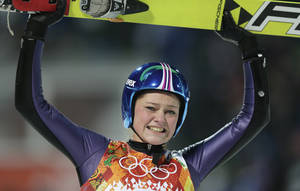 Photo - Germany's Carina Vogt celebrates after winning the gold during the women's normal hill ski jumping final at the 2014 Winter Olympics, Tuesday, Feb. 11, 2014, in Krasnaya Polyana, Russia. (AP Photo/Matthias Schrader)