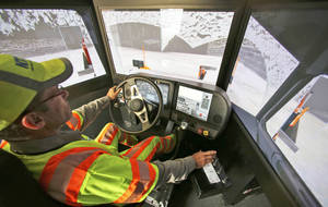 photo - Driver Terence Mundt operates a snowplow simulator during a North Texas Tollway Authority training class Nov. 15 in Plano, Texas.  AP Photo