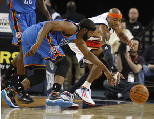 Photo - Oklahoma City Thunder's James Harden, left, and Golden State Warriors' Corey Maggette chase a loose ball during the first half of an NBA basketball game Saturday, Feb. 6, 2010, in Oakland, Calif. AP PHOTO