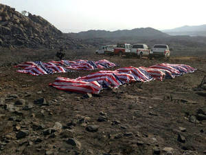 Photo - This photo that appeared anonymously on Facebook on Thursday, July 4, 2013, shows what officials confirmed to The Associated Press, as the 19 dead firefighters draped in American flags by Yavapai County Sheriff Scott Mascher, shortly after they were found dead near Prescott, Ariz., on June 30, 2013. Several media outlets, including the Arizona Republic and USA Today, published the photo on Friday, July 5, 2013. Nineteen members of the Granite Mountain Hotshot crew died Sunday, June 30, 2013 fighting the Yarnell Hills Fire, about 40 miles southwest of Prescott. (AP Photo) AP PROVIDES ACCESS TO THIS HANDOUT PHOTO TO BE USED SOLELY TO ILLUSTRATE NEWS REPORTING OR COMMENTARY ON THE FACTS OR EVENTS DEPICTED IN THIS IMAGE. ONE TIME USE ONLY.