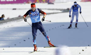 Photo - Russia's Maxim Vylegzhanin approaches the finish line to win the silver medal in the men's 4x10K cross-country relay at the 2014 Winter Olympics, Sunday, Feb. 16, 2014, in Krasnaya Polyana, Russia. (AP Photo/Kirsty Wigglesworth)