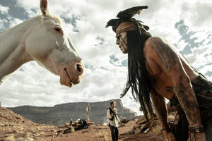"Photo - Johnny Depp stars as Tonto in ""The Lone Ranger."" <strong>Peter Mountain</strong>"