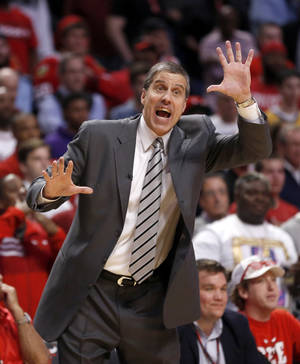 Washington Wizards head coach Randy Wittman directs his team during the second half of Game 2 in an opening-round NBA basketball playoff series against the Chicago Bulls Tuesday, April 22, 2014, in Chicago. The Wizards won 101-99. (AP Photo/Charles Rex Arbogast)