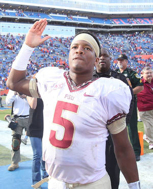 Photo - Florida State quarterback Jameis Winston will not be charged in a sexual assault case.  Photo by Stephen M. Dowell, Orlando Sentinel/MCT