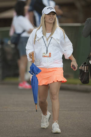 Photo - Justine Reed,wife of golfer Patrick Reed, walks near the first fairway during the second round of the Tournament of Champions golf tournament, Saturday, Jan. 4, 2014, in Kapalua, Hawaii.  (AP Photo/Marco Garcia)