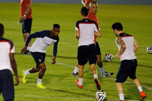 Photo - France's Patrice Evra, second left, run on the field during an official training session at the Joao Havelange Olympic stadium, in Rio de Janeiro, Brazil, Tuesday, June 24, 2014. France will play its next game against Ecuador in group E of the 2014 soccer World Cup. A draw is enough to guarantee top spot for France, and would also send Ecuador through to the next round if Switzerland fails to beat Honduras in the other match. (AP Photo/David Vincent)