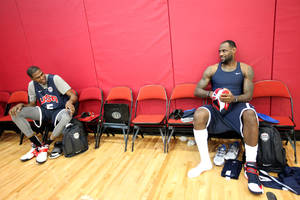 photo - In this Sunday, Juy 8, 2012, photo, U.S. men's basketball team players Kevin Durant, left, and LeBron James chat before practice in Las Vegas. Durant can't hide from the hurt this summer. James is right there every time he steps on the basketball court now. The NBA Finals ended in Miami only about three weeks ago, with James' victory celebration interrupted only briefly to embrace his opponent in a consoling hug.  Durant admits it bothers him coming to the gym and seeing James every day.  (AP Photo/Las Vegas Review-Journal, Jessica Ebelhar) LOCAL TV OUT  LOCAL INTERNET OUT  LAS VEGAS SUN OUT ORG XMIT: NVLAS104