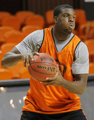 Photo - OSU COLLEGE BASKETBALL: Jean-Paul Olukemi (0) looks to pass the ball during men's basketball practice for the Oklahoma State University Cowboys at Gallagher-Iba Arena in Stillwater, Okla., Monday, Oct. 22, 2012. Photo by Nate Billings, The Oklahoman