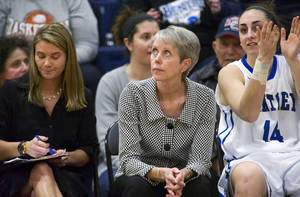 Photo - FILE - In this Jan. 25, 2014, file photo, Bentley women's basketball coach Barbara Stevens, center, looks up at the clock in the final seconds of her team's win over Saint Anselm in an NCAA Division II college basketball game in Waltham, Mass. Stevens is one of six women's basketball coaches with at least 900 wins. Now the undefeated Falcons chase a goal — an NCAA Division II championship. (AP Photo/The Telegram & Gazette, Betty Jenewin, File)