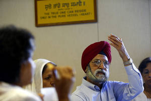 "photo - Sarbjit ""Sabi"" Singh, a retired Oklahoma City engineer, talks about being Sikh in America at a gathering at the Sikh Gurdwara of Oklahoma, 4525 NW 16, where he worships. PHOTOS BY BRYAN TERRY, THE OKLAHOMAN"