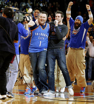 photo - Heath Kufahl, the volleyball and boys basketball coach at Christian Heritage Academy in Del City, Okla., celebrates after making the MidFirst halfcourt shot between the third and fourth quarters of the Thunder-Lakers matchup to win $20,000. during an NBA basketball game between the Oklahoma City Thunder and the Los Angeles Lakers at Chesapeake Energy Arena in Oklahoma City, Tuesday, March. 5, 2013. Photo by Bryan Terry, The Oklahoman