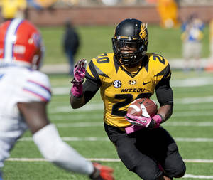 Photo - Missouri running back Henry Josey scores on a 6-yard touchdown run during the third quarter of an NCAA college football game against Florida Saturday, Oct. 19, 2013, in Columbia, Mo. (AP Photo/L.G. Patterson)