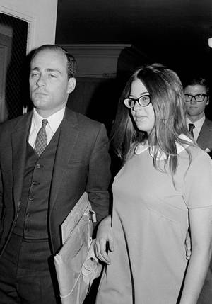"Photo -   FILE - In this Sept. 23, 1970 file photo, Barbara Hoyt, 19, former member of Charles Manson's hippie ""family"" arrives at court to testify as a prosecution witness in the Tate-La Bianca murder trial in Los Angeles. On Aug. 9, 1969, two naive 17-year-olds were launched on a path toward the most unlikely of friendships. That infamous night four young people under the sway of a charismatic career criminal slipped into a home in a neighborhood of Hollywood glitterati, then bludgeoned and stabbed rising young actress Sharon Tate, her friend and coffee heiress Abigail Folger, and two others. (AP Photo/Wally Fong, File)"