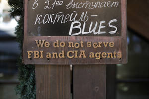 "Photo - A sign that says ""We do not serve FBI and CIA agents,"" hangs outside a restaurant on the opening day of the 2014 Winter Olympics, Friday, Feb. 7, 2014, in Krasnaya Polyana, Russia. (AP Photo/Jae C. Hong)"