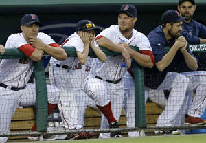 Photo - Boston Red Sox starting pitcher Jon Lester, second right, watches from the dugout in the second inning of an exhibition baseball game against the Minnesota Twins in Fort Myers, Fla., Thursday, March 27, 2014. The Red Sox announced today that Lester will be the starting pitcher on opening day.  (AP Photo/Gerald Herbert)