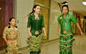 Photo - Katallina Hubbard, Alicia Fink and Skye Wapskineh practice an American Indian dance in a school hallway. Photo by M. Tim Blake, for The Oklahoman <strong>M. Tim Blake</strong>