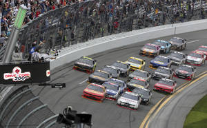 Photo - Regan Smith, front left, races the field to the checkered flag to win the NASCAR Nationwide Series auto race at Daytona International Speedway in Daytona Beach, Fla., Saturday, Feb. 22, 2014. (AP Photo/David Graham)