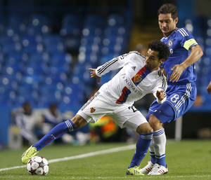 Photo - FILE - This is a  Wednesday, Sept.  18, 2013 file photo of Basel's Mohamed Salah, left, as he holds the ball away from Chelsea's Frank Lampard  during the Champions League group E soccer match between Chelsea and Basel at Stamford Bridge stadium in London, Wednesday, Sept.  18, 2013.  Chelsea said Thursday Jan 23, 2014 that it has struck a deal with Swiss club FC Basel to sign midfielder Mohamed Salah. The Premier League club says the Egypt international's move is subject to him agreeing to personal terms and completing a medical. (AP Photo/Kirsty Wigglesworth, File)