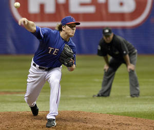 Photo - Texas Rangers' Daniel McCutchen pitches during a spring exhibition baseball game against the Houston Astros on Saturday, March 29, 2014, in San Antonio. (AP Photo/Darren Abate)