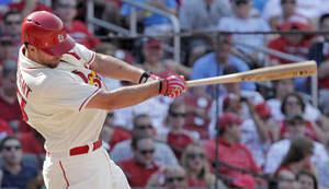 Photo - St. Louis Cardinals starting pitcher Adam Wainwright connects for a double in the fifth inning of a baseball game against the Philadelphia Phillies, Saturday, June 21, 2014, in St. Louis. (AP Photo/Tom Gannam)