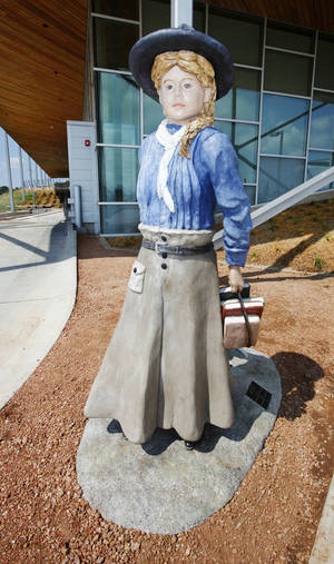 "Photo - The sculpture ""Lucille Mulhall, First Cowgirl"" by Solomon Bassoff has been installed outside the Patience S. Latting Northwest Library  in Oklahoma City.   Photo by Paul B. Southerland, The Oklahoman <strong>PAUL B. SOUTHERLAND - PAUL B. SOUTHERLAND</strong>"