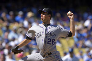 Photo - Colorado Rockies starting pitcher Jeff Francis throws to the plate during the first inning of the Rockies' baseball game against the Los Angeles Dodgers, Sunday, Sept. 29, 2013, in Los Angeles.  (AP Photo/Mark J. Terrill)