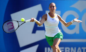 Photo - Italy's Flavia Pennetta returns a shot to Heather Watson during the Aegon International tennis tournament at Devonshire Park, Eastbourne, southern England, Wednesday June 18, 2014. (AP Photo/PA, John Walton)  UNITED KINGDOM OUT  NO SALES  NO ARCHIVE