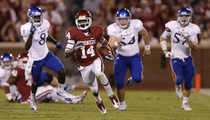 photo - OU's Jalen Saunders (14) returns a kick against KU during the college football game between the University of Oklahoma Sooners (OU) and the University of Kansas Jayhawks (KU) at Gaylord Family-Oklahoma Memorial Stadium on Saturday, Oct. 20th, 2012, in Norman, Okla. Photo by Chris Landsberger, The Oklahoman