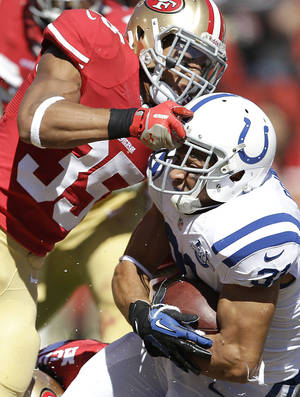 Photo - San Francisco 49ers safety Eric Reid (35) tackles Indianapolis Colts running back Donald Brown during the second quarter of an NFL football game, Sunday, Sept. 22, 2013, in San Francisco. (AP Photo/Aaron Kehoe)