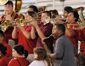Photo - The U.S. Grant band plays during a  football game between U.S. Grant and Capitol Hill on Thursday. Photo by Nate Billings, The Oklahoman <strong>NATE BILLINGS - NATE BILLINGS</strong>