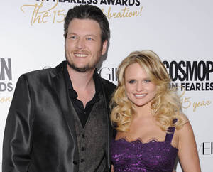 "Photo - FILE - This March 5, 2012 file photo shows country singers Blake Shelton, left, and his wife, Miranda Lambert at Cosmopolitan Magazine's ""Fun Fearless Males and Females of 2012"" awards in New York. Shelton's ""Mine Would Be You"" and Miranda Lambert's ""Mama's Broken Heart"" are both nominated for a Grammy award for best country solo performance. (AP Photo/Evan Agostini, file)"