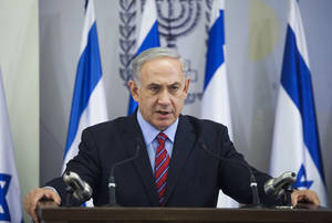 Photo - Israeli Prime Minister Benjamin Netanyahu speaks to the media in Tel Aviv, Israel, Sunday, June 15, 2014. Netanyahu has condemned Palestinian President Mahmoud Abbas' agreement with the militant group, and said he would hold him responsible for the safety of the youths, who disappeared apparently while hitchhiking in the West Bank late Thursday. (AP Photos/Dan Balilty)