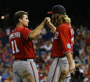 Photo - Washington Nationals' Ryan Zimmerman, left, and Jayson Werth celebrate after Zimmermann hit the go-ahead RBI-single in the 10th inning of a baseball game against the Philadelphia Phillies, Saturday, July 12, 2014, in Philadelphia. Washington won 5-3 in 10 innings. (AP Photo/Matt Slocum)