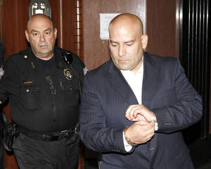 photo - Former Oklahoma City police Sgt. Maurice A. Martinez is escorted Tuesday from a courtroom at the Oklahoma County Courthouse.