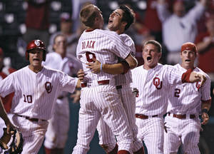 Photo - Oklahoma's Tyler Ogle (35) reacts with teammate Danny Black (9) after Ogle's game winning score during the bottom of the ninth inning in the Sooners' 3-2 win in the fourth game of the Big 12 Baseball Championship between Oklahoma and Kansas at the Bricktown Ballpark on Wednesday, May 26, 2010, in Oklahoma City, Okla. Photo by Chris Landsberger, The Oklahoman