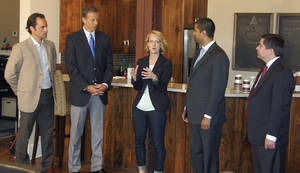 Photo - Karla Santi of Blend Interactive tells how her Web design and development company uses the Internet in Sioux Falls, S.D., on Thursday, May 29, 2014. Joining her from left are Michael Beckerman with The Internet Association, Sen. John Thune, and Federal Communications Commissioners Ajit Pai and Michael O'Rielly. (AP Photo/Carson Walker)