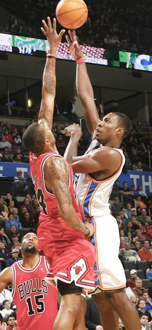 Photo - Chicago's Tyrus Thomas, left, defends on Oklahoma City's Jeff Green during the second half Wednesday at the Ford Center. Photo by Chris Landsberger, The Oklahoman