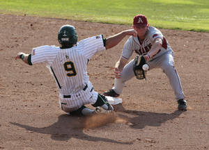 Photo -   Arkansas' Tim Carver, right, tags out Baylor Max Muncy (9) in the second inning of an NCAA college baseball tournament super regional game, Monday, June 11, 2012, in Waco, Texas. (AP Photo/Waco Tribune Herald, Jerry Larson)