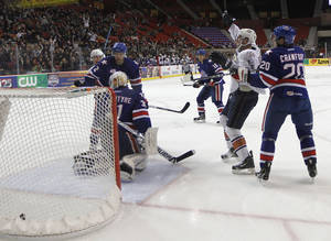 photo - AHL HOCKEY / CELEBRATION: OKC's Josh Green (12) celebrates after scoring a goal during a game between the Oklahoma City Barons and the Rochester Americans at the Cox Convention Center in Oklahoma City, Tuesday, Dec. 27, 2011.  Photo by Garett Fisbeck, The Oklahoman  ORG XMIT: KOD