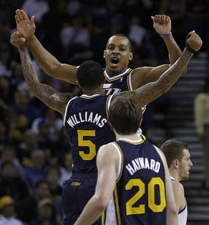 Photo - Utah Jazz' Mo Williams (5) and Randy Foye celebrate during the final seconds of an NBA basketball game against the Golden State Warriors Sunday, April 7, 2013, in Oakland, Calif. (AP Photo/Ben Margot)
