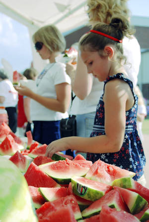 Photo - Free watermelon is on the menu at Parkfest during Edmond's LibertyFest. PHOTO PROVIDED.  <strong></strong>
