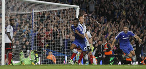 Photo - Chelsea's Mikel, centre, runs as he celebrates after scoring a goal against Fulham during the English Premier League soccer match between Chelsea and Fulham at Stamford Bridge, London, Saturday, Sept. 21, 2013. (AP Photo/Sang Tan)
