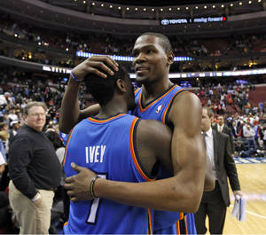 Photo - Oklahoma City's Kevin Durant, right reacts with teammate Royal Ivey after a 2012 win over Philadelphia. AP PHOTO <strong>Alex Brandon</strong>