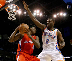 photo - Oklahoma City's Nazr Mohammed (8) defends Los Angeles Clippers' Brian Cook (3) during the NBA basketball game between the Oklahoma City Thunder and the Los Angeles at the Oklahoma City Arena, Wednesday, April 6, 2011. Photo by Bryan Terry, The Oklahoman