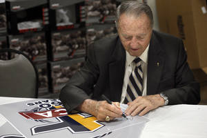 Photo - Former Florida State football coach Bobby Bowden signs autographs at FCA Banquet in Oklahoma CIty,Tuesday, April 15, 2014. Photo by Sarah Phipps, The Oklahoman