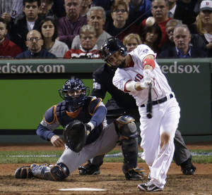 Photo - Boston Red Sox's Shane Victorino hits a grand slam against the Detroit Tigers in the seventh inning during Game 6 of the American League baseball championship series on Saturday, Oct. 19, 2013, in Boston. (AP Photo/Charlie Riedel)